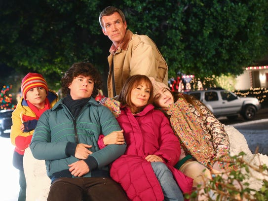 The young actors who play the Heck children have grown up over nine seasons, as this photo from the 2013 Christmas episode illustrates: Atticus Shaffer, left, Charlie McDermott, Neil Flynn, Patricia Heaton and Eden Sher.
