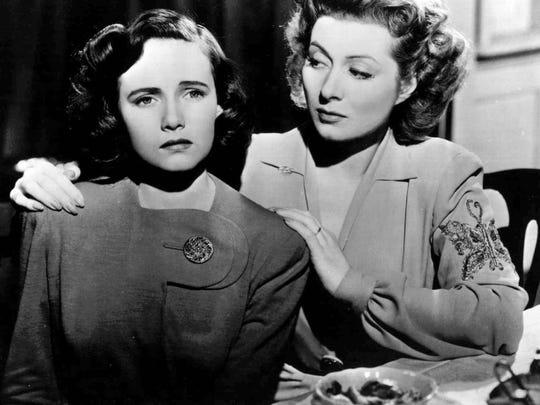 "Teresa Wright (left)  and Greer Garson star in the 1942 classic ""Mrs. Miniver."""