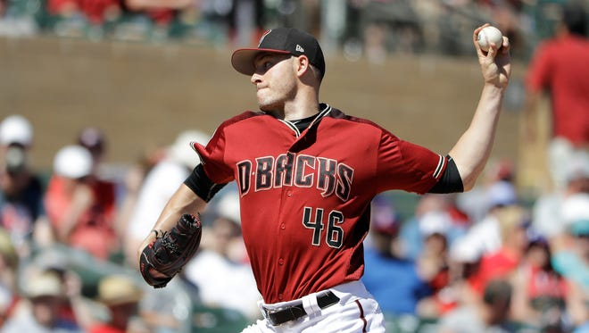 Arizona Diamondbacks' Patrick Corbin throws during the first inning of a spring training baseball game against the Texas Rangers, Tuesday, March 14, 2017, in Scottsdale, Ariz.