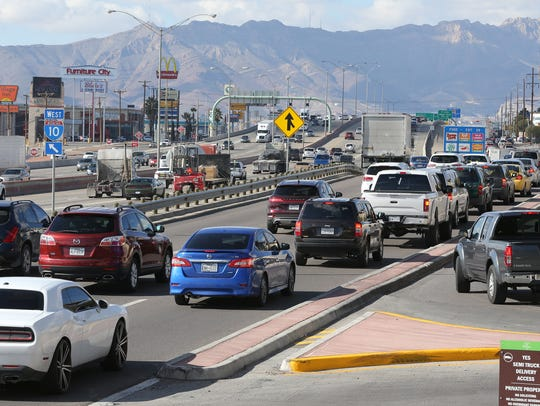 Motorists merge in and out of traffic in front of The