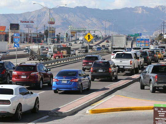 Motorists merge in and out of traffic in front of The Fountains at Farah during a busy shopping day Tuesday.
