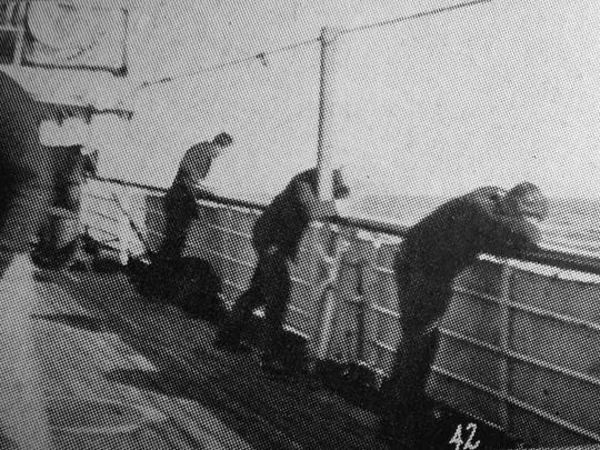 """Seasick players were """"leaning far over the rails"""" of the S.S. Manoa during the Colorado Agricultural College football team's 1925 trip to Hawaii, passengers said."""
