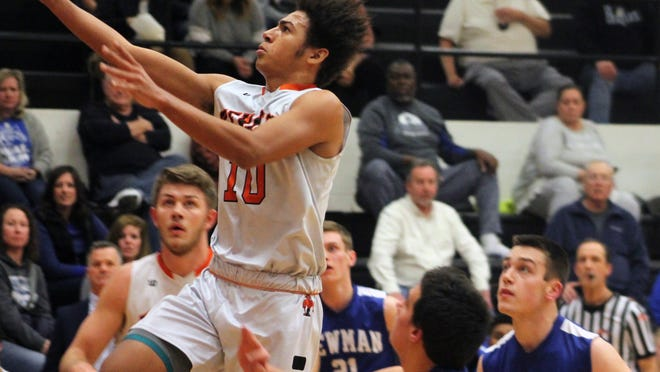 Kewanee guard Niko Powe drives to the hoop on Tuesday against Newman Central Catholic.