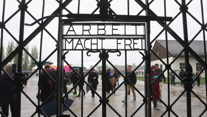 A general view of  entrance gate of the Dachau concentration camp during a ceremony to commemorate the 70th anniversary of the liberation at the memorial site on the grounds of the former concentration camp on May 3, 2015 in Dachau, Germany. Dachau was the first Nazi concentration camp and began operation in 1933 to hold political prisoners, though it later expanded to include Jews, common criminals and foreign nationals. It served mainly as a source of slave labour during World War II and included approximately 100 sub-camps spread across southern Germany and Austria. At least 30,000 inmates died before its liberation by U.S. troops in 1945.