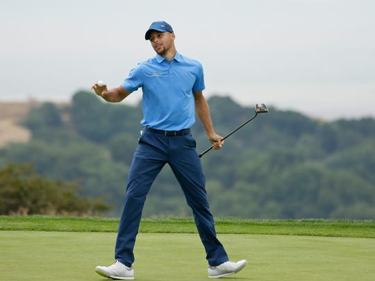 Golden State Warriors NBA basketball player Stephen Curry reacts after saving par on the 18th green during the Web.com Tour's Ellie Mae Classic golf tournament Thursday, Aug. 3, 2017, in Hayward, Calif. (AP Photo/Eric Risberg)