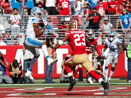 Detroit Lions wide receiver Marvin Jones Jr. catches the ball for a touchdown as San Francisco 49ers cornerback Ahkello Witherspoon looks on during the second half of an NFL football game in Santa Clara, Calif., Sunday, Sept. 16, 2018. (AP Photo/Tony Avelar)