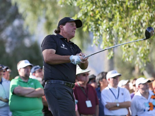 Phil Mickelson tees off on the 5th hole at La Quinta County Club during the Humana Challenge on Thursday, January 21, 2015.