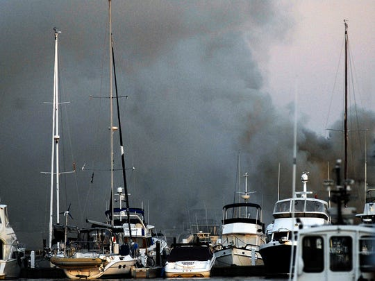 Thick smoke billowed from the Quarterdeck Marina after a boat apparently caught on fire about 7 pm Monday night on the Sturgeon Bay Canal.