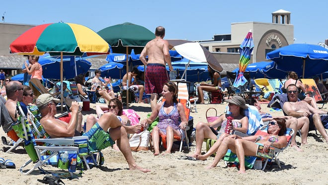 Great weather brings out visitors to Rehoboth Beach to enjoy the sun and sand and boardwalk as Fourth of July weekend gets started along Delaware's coast.