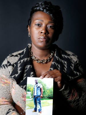 Anternitia O'Neal holds a picture of her son, Dontez O'Neal, who was shot and killed by Cincinnati Police officer in 2012 in circumstances she disputes. Photo shot Monday October 24, 2016.