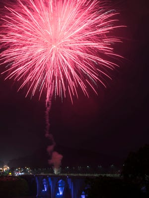 Fireworks ignite over Henley Bridge and Fort Loudoun Lake for the Festival on the Fourth on Tuesday, July 4, 2017.
