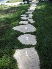 One property owner along Geneva Lake turned part of the shore path into a hopscotch game.
