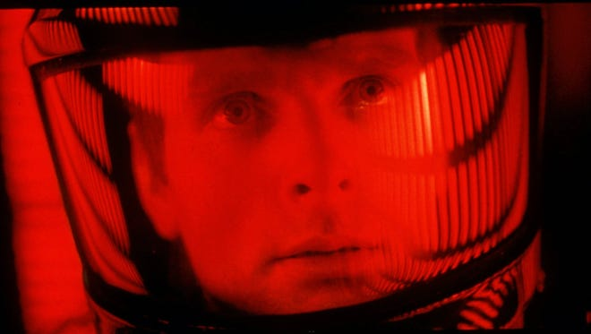 "Actor Keir Dullea peers through his space helmet in Stanley Kubrick's 1968 film, ""2001: A Space Odyssey."""