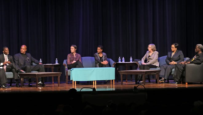 """Michelle Alexander, author of """"The New Jim Crow"""" spoke at a community gathering in the MATC Cooley Auditorium in Milwaukee. The panel discussion included (left to right) moderator James Causey, Judge Carl Ashley, Torre Johnson, Jenna Loyd, Michelle Alexander, Lois Quinn,  Darienne Driver and Andre Lee Ellis."""