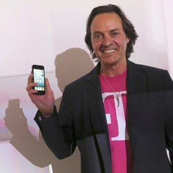 T-Mobile CEO John Legere speaks during a news conference Tuesday, March 26, 2013 in New York. (AP Photo/Mary Altaffer) ORG XMIT: NYMA102