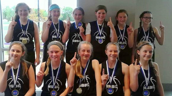 The North Buncombe Basketball Club's sixth-grade girls team won the Carolina Crusaders Classic tournament last weekend in Greenville, S.C.