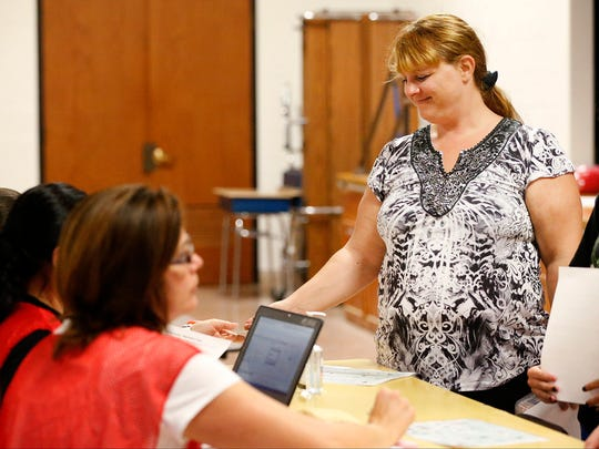 Shanatha Crandall, of Horseheads, submits medical information to Chemung County Health Department officials while participating in an emergency preparedness drill Wednesday evening at Horseheads Intermediate School, 950 Sing Sing Road.