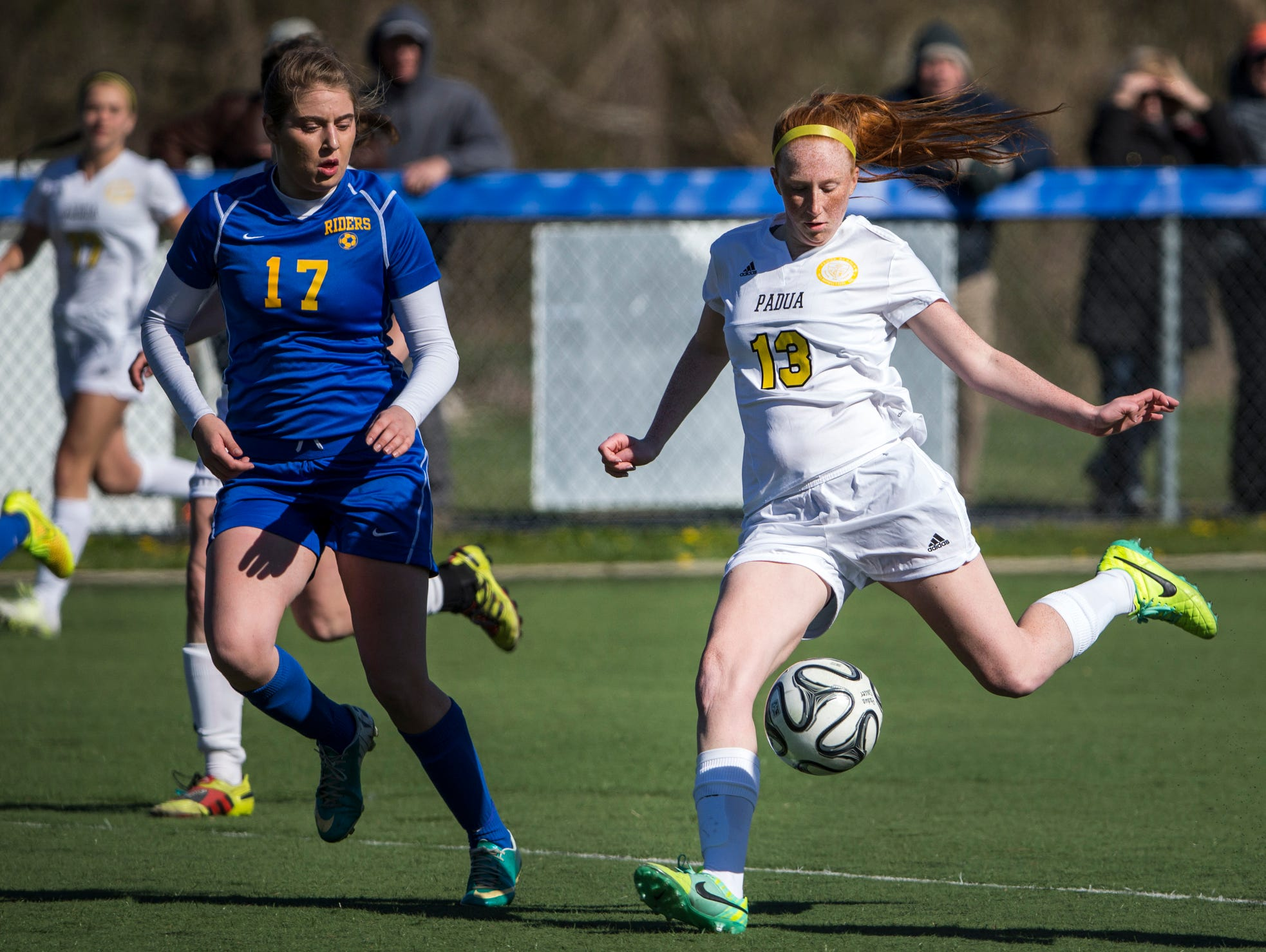 Padua's Megan Mallon (right) puts a shot on goal in the second half of Padua's 2-0 win over Caesar Rodney at the Hockessin Soccer Club on Tuesday afternoon.