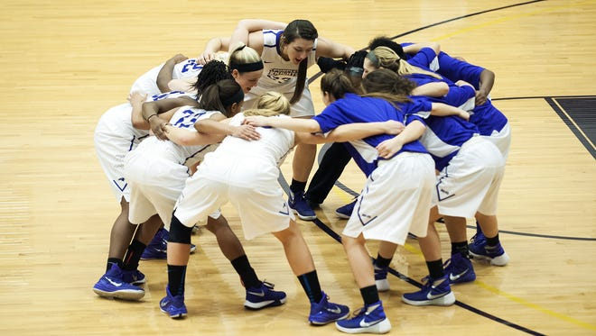 St. Michael's huddles together during the women's basketball game between Southern New Hampshire and St. Michael's at the Ross Sport Center on Saturday afternoon in Colchester.