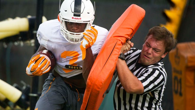 Tennessee's running back Ty Chandler (3) participates in a drill during a University of Tennessee fall football practice at Anderson Training Facility in Knoxville, Tenn. on Tuesday, Aug. 1, 2017.