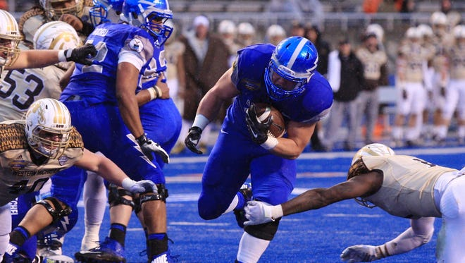 Dec 20, 2014; Boise, ID, USA; Air Force Falcons running back Shayne Davern (43) runs through the line of scrimmage for positive yardage during the first half of the Famous Idaho Potato Bowl verses the Western Michigan Broncos  at Albertsons Stadium. Mandatory Credit: Brian Losness-USA TODAY Sports