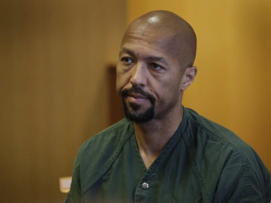Ex-Detroit City Council president and former TV news anchor Charles Pugh returns to a Detroit courtroom on Friday, August 5, 2016 at the Frank Murphy Hall of Justice in Detroit.