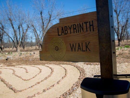 A sign points to the Labyrinth Walk at the Holy Cross