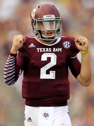 Johnny Manziel threw for three touchdowns in the Aggies' season-opening win.