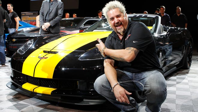 "Guy Fieri, host of Diners, Drive Ins, and Dives, loves cars and now he has his Lamborghini back. Here, he shows off his ""cooked up"" Chevrolet Corvette C6 special edition"