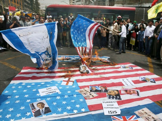 Iranian demonstrators burn representations of U.S.