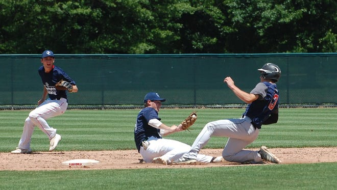 Olympic/Colonial shortstop Nolan Gerold tags out Joe Goria of Chester County during action in fifth inning Monday.