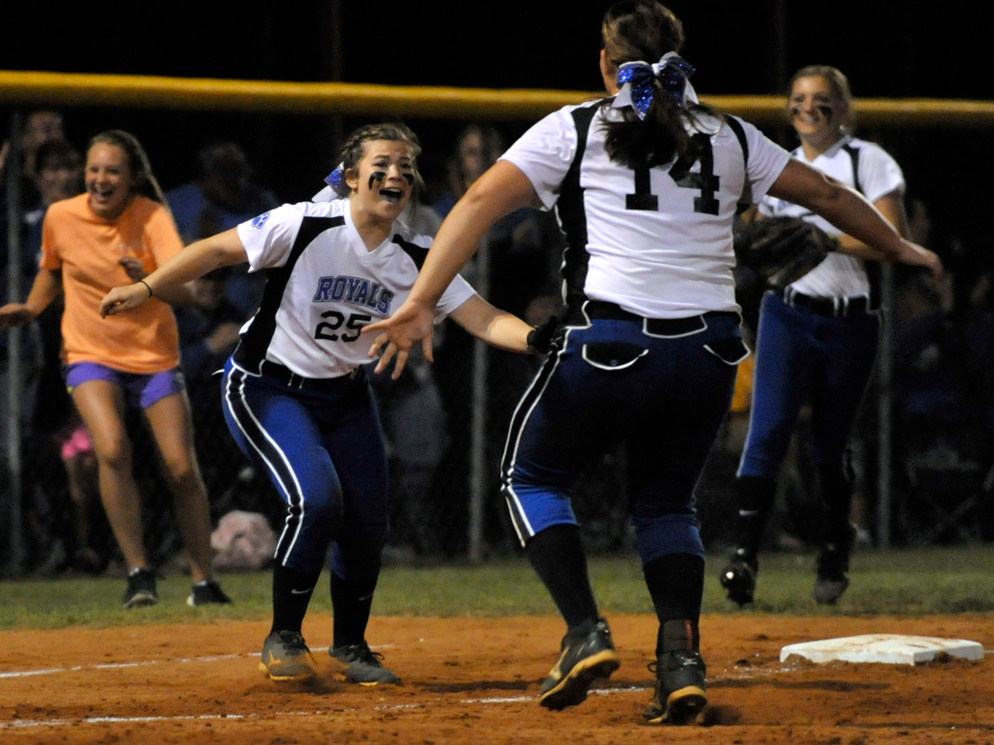 Kolby Bray, No. 25 of the Jay Royals, rushes over to teammate Destiny Herring to celebrate Jay beating the Chipley Tigers.