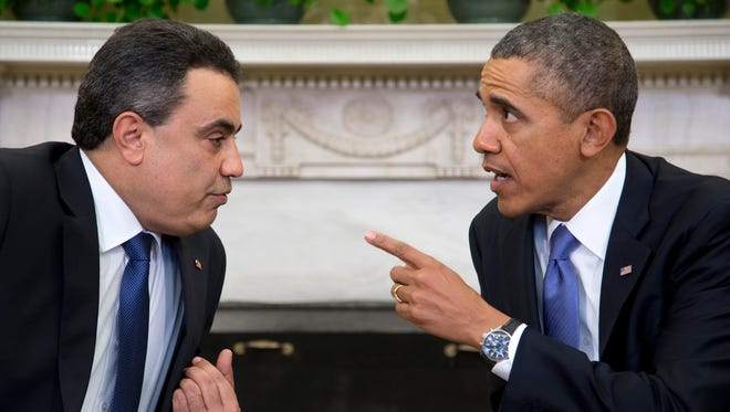President Obama meets with Tunisian Prime Minister Mehdi Jomaa, Friday, April 4, 2014,  in the Oval Office of the White House in Washington.