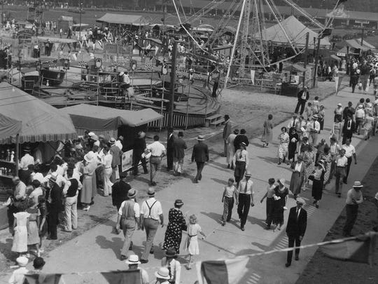 The scene along the promenade on opening day of the 1934 Oregon State Fair. A record 185,000 visitors come through the gates during the fair.