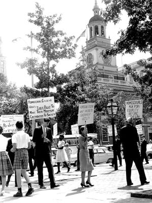 On July 4, 1965, 40 people carried signs in front of Independence Hall in Philadelphia, supporting gay equality.