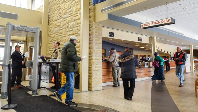 Drivers enter the Stearns County Service Center to renew their tabs and licenses Friday, March 2, in Waite Park.