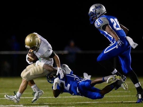 York Catholic's Brandon Creisher slips the grip of