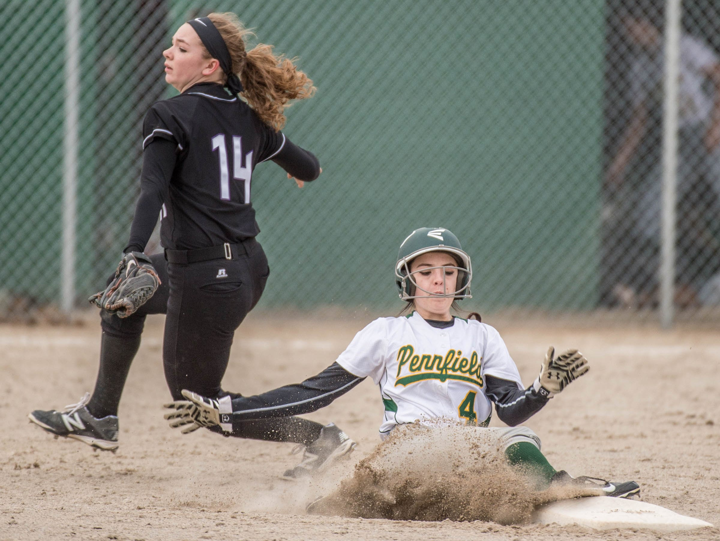 Pennfield's Lexi Purvis (4) slides into second base as Lakeview's Kim Kucharczyk (14) during a recent game.