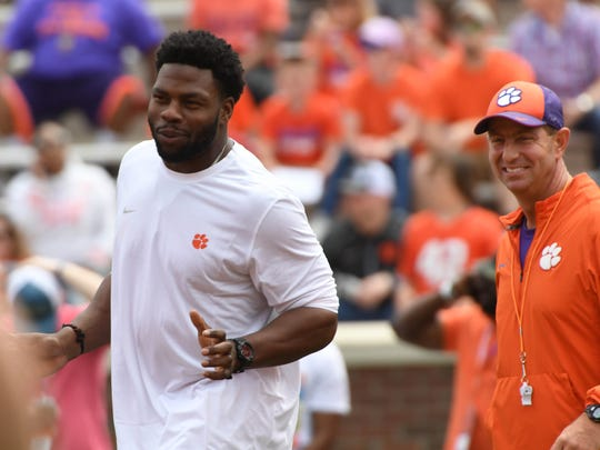 Clemson head coach Dabo Swinney and former player Dwayne Allen during warm ups for the Spring game in Memorial Stadium in Clemson on Saturday, April 14, 2018.