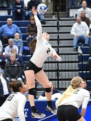 Michigan State's Autumn Bailey serves the final point,