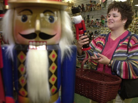 Nov. 21, 2002: Brenda Hand of Medina picked out a Christmas Nutcracker figure for a gift  at Ridge Road Station in Holley.