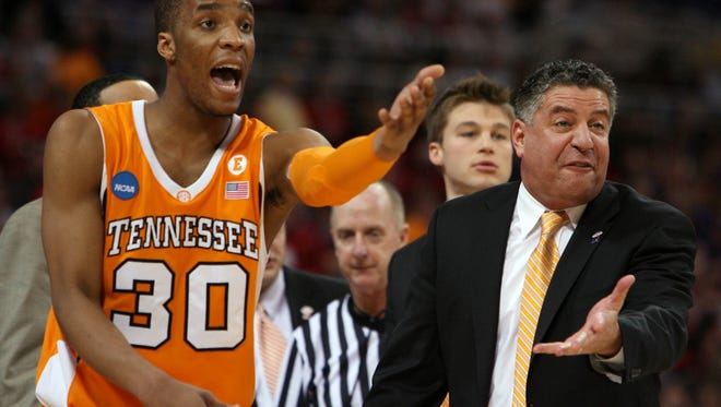 Tennessee's J.P. Prince and coach Bruce Pearl react to a foul called against the Vols during the game against Ohio State in the NCAA tournament Sweet Sixteen at the Edward Jones Dome in St. Louis, Mo., on March 26, 2010.