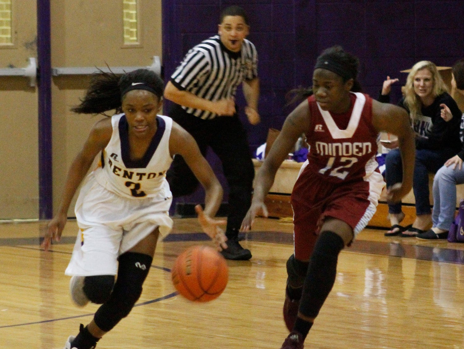 Minden's Bre Rogers (right) defends against Benton's Qua Chambers during Friday's game at Benton.