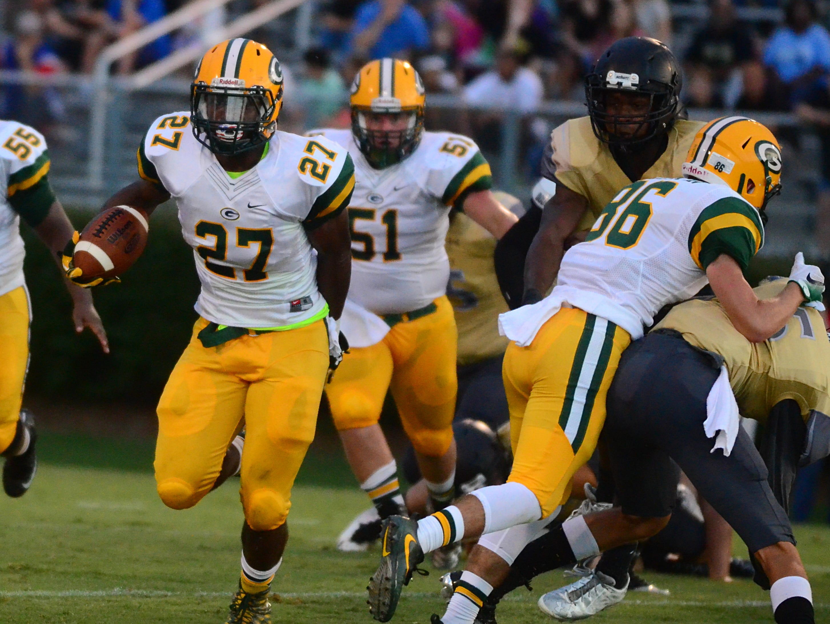 Gallatin senior Matthew Knights (86) blocks ahead of classmate Jordan Mason during first-quarter action. Mason rushed for 250 yards and one touchdown on 20 carries in Friday's 26-6 loss at Mt. Juliet.
