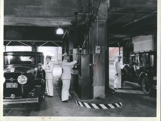 Today most parking garages being built are combined with larger officer, shopping or government complexes, but the parking garage built into the Fisher Building 87 years ago was probably the first of that type, visionary in concept. Here is how it looked in 1928, with white-suited attendants to park your car while your chauffeur waited in the special lounge on the fifth floor.