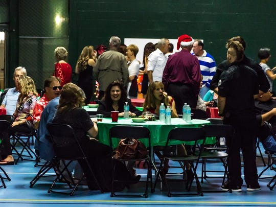 People enjoy the Jungle Club's annual Christmas party.