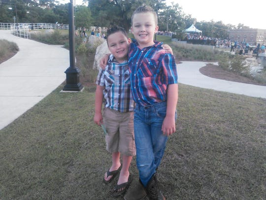 Mason and Aden Rhinehart. Mason was fatally stabbed in the chest Tuesday. His grandmother, Martha White, 63, has been charged with first-degree murder in his death.