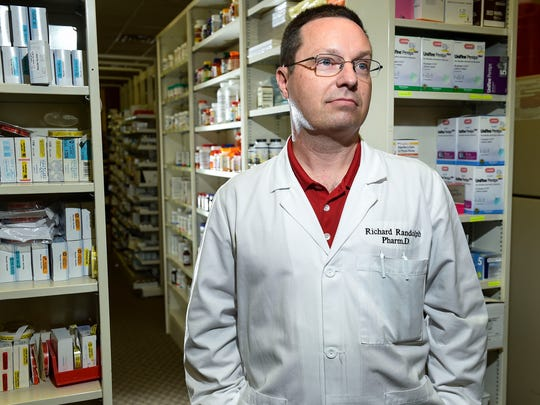 Richard Randolph, pharmacist at Marcrom's Pharmacy in Manchester, Tenn., sees the importance of using personal lockboxes to secure medications.