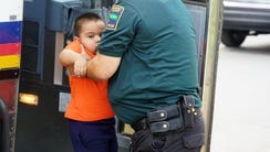 A migrant boy released from federal custody gets help