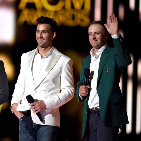 Jake Owen and  Jordan Spieth speak onstage during the 50th Academy Of Country Music Awards at AT&T Stadium on April 19, 2015 in Arlington, Texas.
